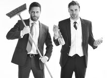 Business people with beards and mop. Businessmen cleaning. Business people with beards and mop. Bearded friends in formal suits with serious faces and sweep royalty free stock image
