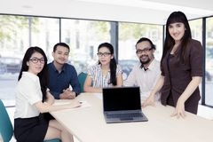 Business people with blank laptop in the office Royalty Free Stock Images