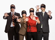 Business people in blindfolds stock images