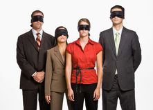 Business people in blindfolds Stock Photography