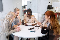 Business people board meeting in modern office. While sitting at round table Royalty Free Stock Photography