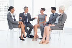 Business people in board room meeting. At the office Royalty Free Stock Photo