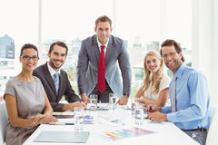 Business people in board room meeting. Portrait of young business people in board room meeting at the office Royalty Free Stock Photo