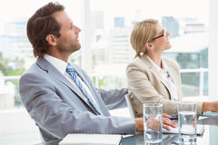 Business people in board room meeting. Two young business people in board room meeting at office Royalty Free Stock Photos