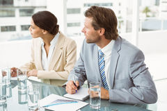 Business people in board room meeting. Two young business people in board room meeting at office Royalty Free Stock Photography