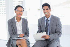 Business people in board room meeting. Two young business people in board room meeting at office Royalty Free Stock Images