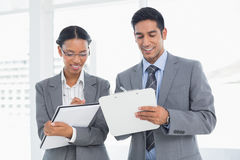 Business people in board room meeting. Two young business people in board room meeting at office Stock Images