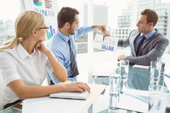 Business people in board room meeting. Young business people in board room meeting at the office Royalty Free Stock Photos