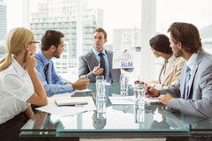 Business people in board room meeting. Young business people in board room meeting at the office Stock Image