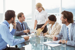 Business people in board room meeting. Young business people in board room meeting at the office Stock Photography