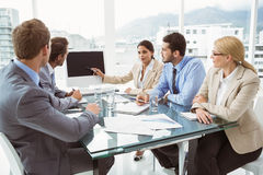 Business people in board room meeting. Young business people in board room meeting at office Royalty Free Stock Photography