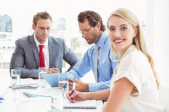 Business people in board room meeting. Young business people in board room meeting at office Royalty Free Stock Image