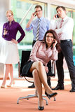 Business people - boss and employees in office stock photo