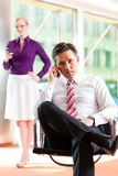 Business people - boss and secretary in office Stock Images