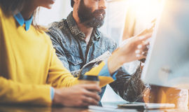 Business people brainstorming concept.Young team of coworkers working together in modern coworking office.Bearded man Royalty Free Stock Images