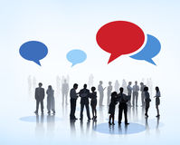 Business People Brainstorming with Speech Bubbles Stock Photo