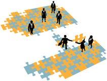 Business people build bridge join teams. Group of business people build a bridge solution to connect teams Royalty Free Stock Image