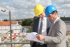 Business people on building site Stock Photography