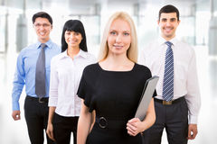 Business people with businesswoman leader. Group of business people with businesswoman leader on foreground royalty free stock image