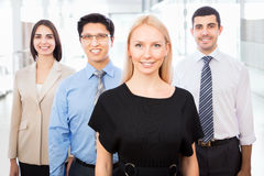 Business people with businesswoman leader Stock Images