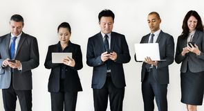 Business people busy on gadgets Royalty Free Stock Image