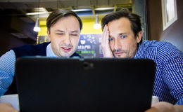Businessmen are disappointed for the tablet, indoor Royalty Free Stock Photo