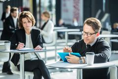 Business people in cafe royalty free stock image