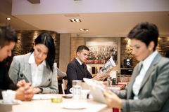 Business people in cafe Royalty Free Stock Photography