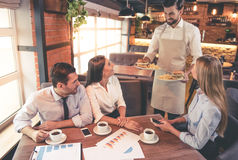 Business people in cafe Stock Images