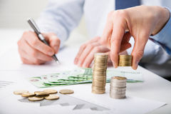 Business people calculating profit Stock Image