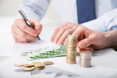 Business people calculating profit Stock Images