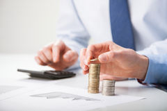 Business people calculating profit Royalty Free Stock Photo