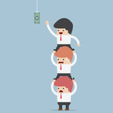 Business people carrying each other to reach hanging money stock illustration