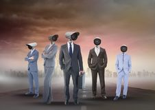Business people with CCTV head on street. Digital composite of Business people with CCTV head on street Stock Photography
