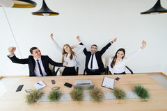 Business people celebrate begin of free time in meeting room royalty free stock photos