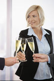 Business people celebrating with champagne Stock Image