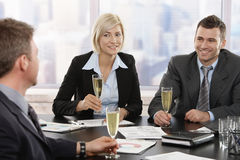 Business people celebrating with champagne Stock Photos