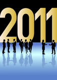 Business people celebrating New Year 2011. Business people in different situations is celebrating New Year 2011 in front of a big golden 2011 sign Royalty Free Stock Image
