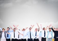 Business people celebrating success under grey sky Stock Photo