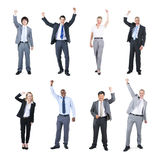 Business People Celebrating with their Hands Raised Stock Photo