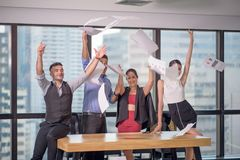 Business people celebrating by throwing their business papers and documents fly in air, Power of cooperation, Success teamwork stock image