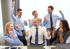 Business people celebrating victory in office Stock Images