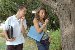 Business people on cell phones. Business people using mobile phones outside an office Royalty Free Stock Image