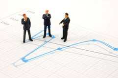 Business people on chart background Royalty Free Stock Photography
