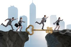 The business people chasing each other towards key to success Stock Images