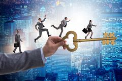 The business people chasing each other towards key to success Stock Image