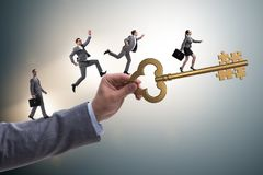 The business people chasing each other towards key to success Stock Photos