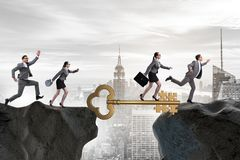 The business people chasing each other towards key to success Royalty Free Stock Images