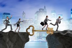 The business people chasing each other towards key to success Stock Photo