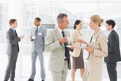 Business people chatting at a conference Royalty Free Stock Images